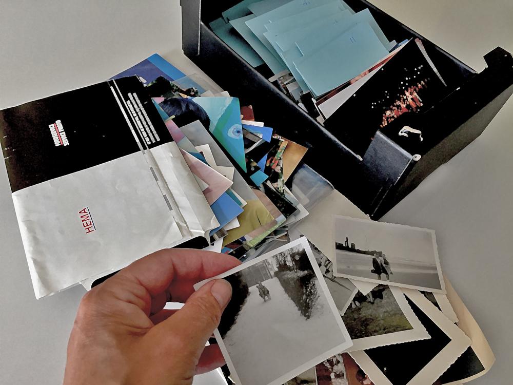 Mapjes met foto's, uitzoeken van foto's